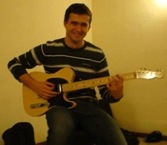 Aitor playing guitar