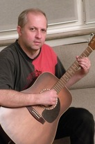 Andrzej playing guitar